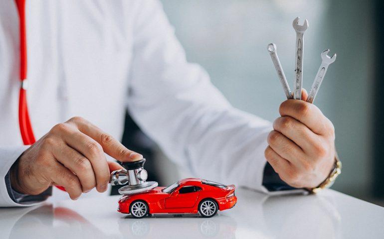 car-technician-with-stethoscope-car-showroom